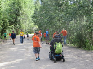 4-H youth volunteering at Easter Seals camp
